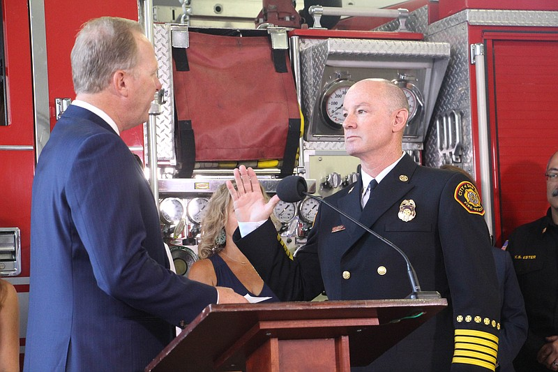 San Diego Mayor Kevin Faulconer swears in Colin Stowell as the San Diego Fire...