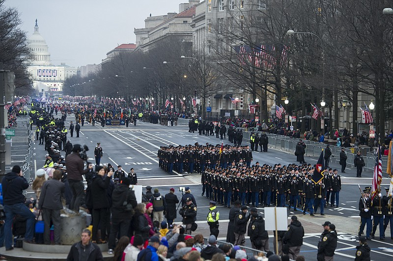 Military units participate in the inaugural parade from the Capitol to the Wh...