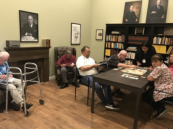 Alzheimer's patients play games and read books at the 195...