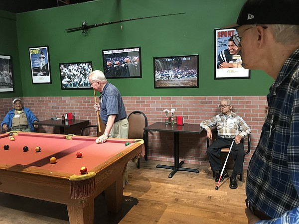 Men with Alzheimer's disease play pool and shoot hoops at...
