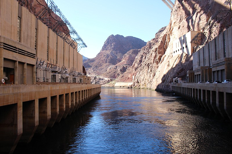 The Colorado River, which flows out of Hoover Dam at the Arizona-Nevada borde...