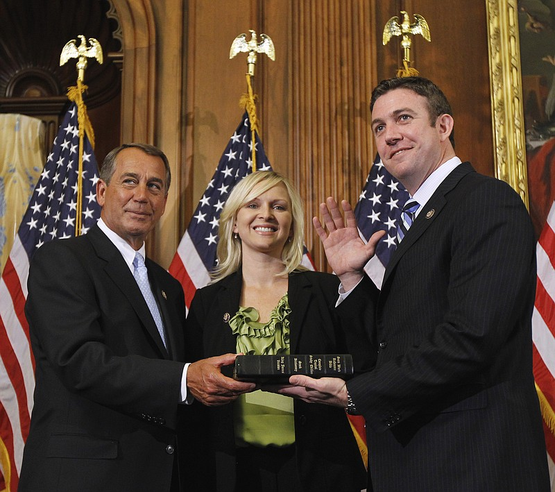 House Speaker John Boehner of Ohio, left, administers the House oath to Rep. ...