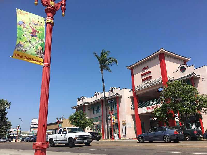 A banner hangs from a lamppost along El Cajon Boulevard in the Little Saigon ...