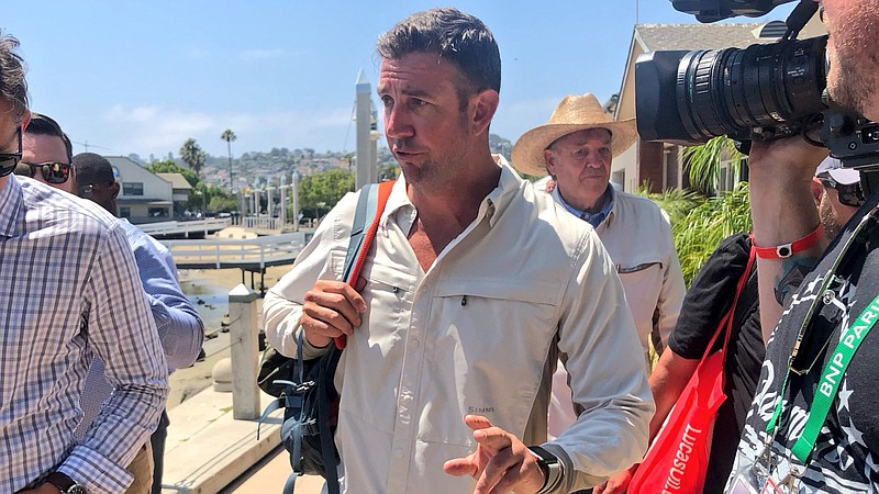 Rep. Duncan Hunter, R-Alpine, speak with reporters in Point Loma after a fish...