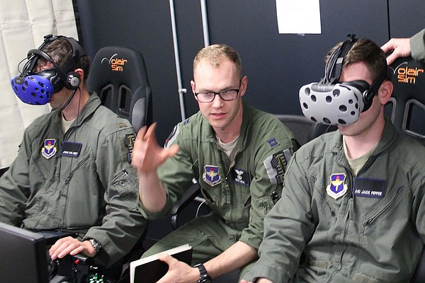 Instructor pilot Capt. Grizz Neal (right) oversees Lt. Jo...