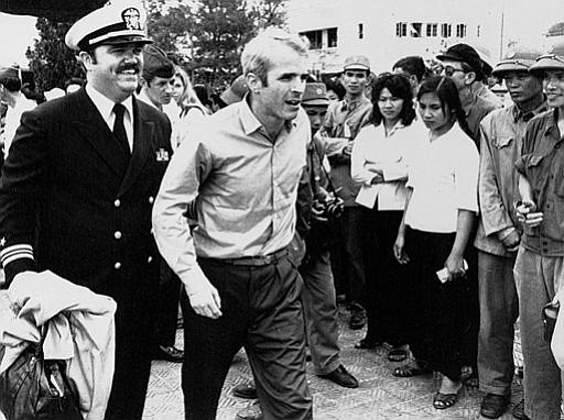John S. McCain III is escorted by Lt. Cmdr. Jay Coupe Jr., public relations o...