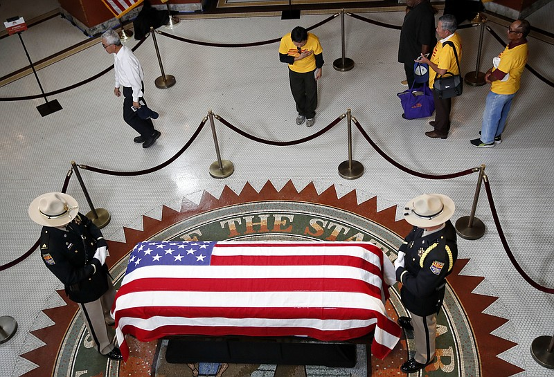 A Vietnamese group from Orange County, Calif., pays their respects near the c...