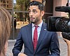 Ammar Campa-Najjar speaks with the media outsid...