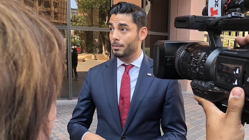 Ammar Campa-Najjar speaks with the media outside the federal courthouse downt...