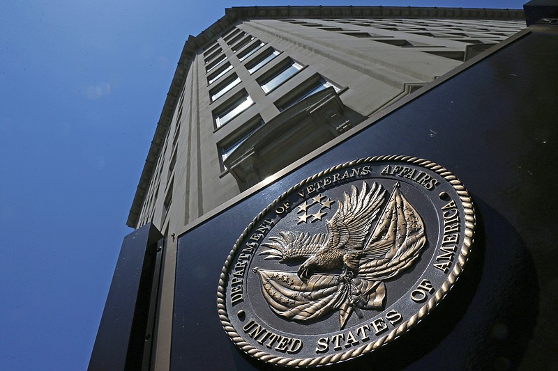 The seal affixed to the front of the Department of Veterans Affairs building ...