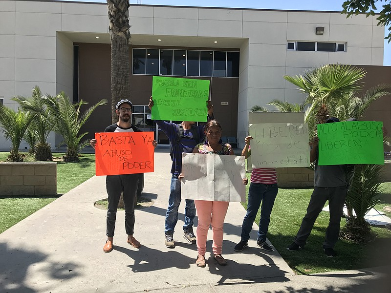Members of Pueblo Sin Fronteras protest in from of the Tijuana jail where two...