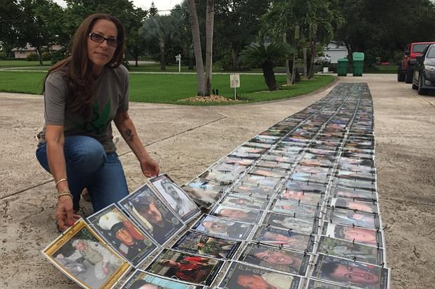 Janine Lutz displays her Memorial Wall, which she built with photos of vetera...