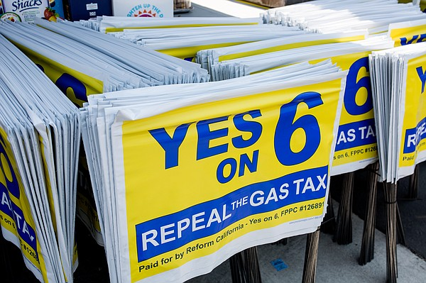 Lawn signs for the Yes on 6 campaign at a volunteering ev...
