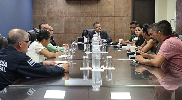 Tijuana's police chief meets with migrant rights activist...