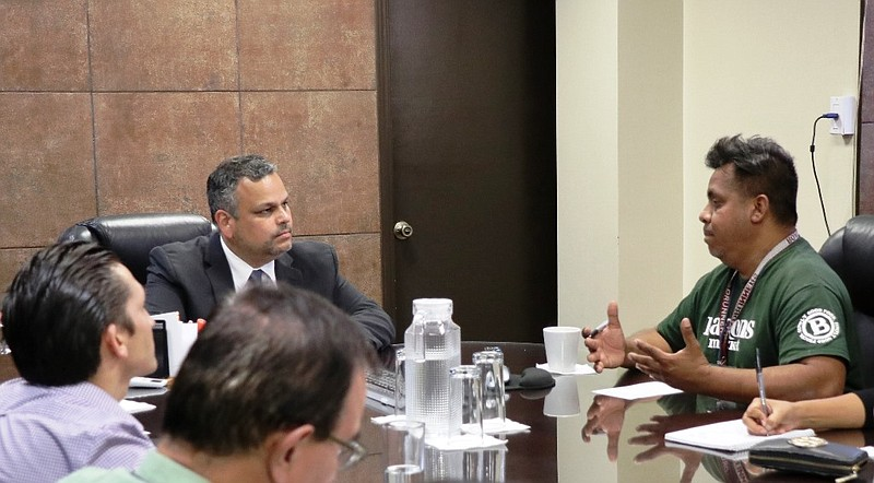 Tijuana's police chief meets with migrant rights activists including Irineo M...