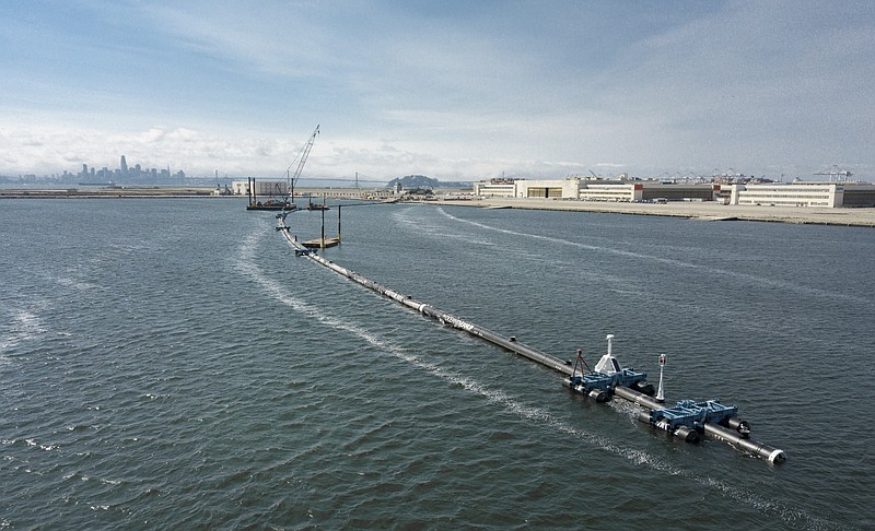 In this Monday, Aug. 27, 2018 photo provided by The Ocean Cleanup, a long flo...