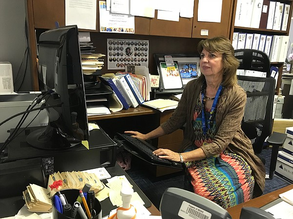 Kim Wyard works in her office at a Northeast Valley Healt...