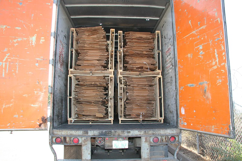 A truck container filled with bailed cardboard is pictured in this undated ph...