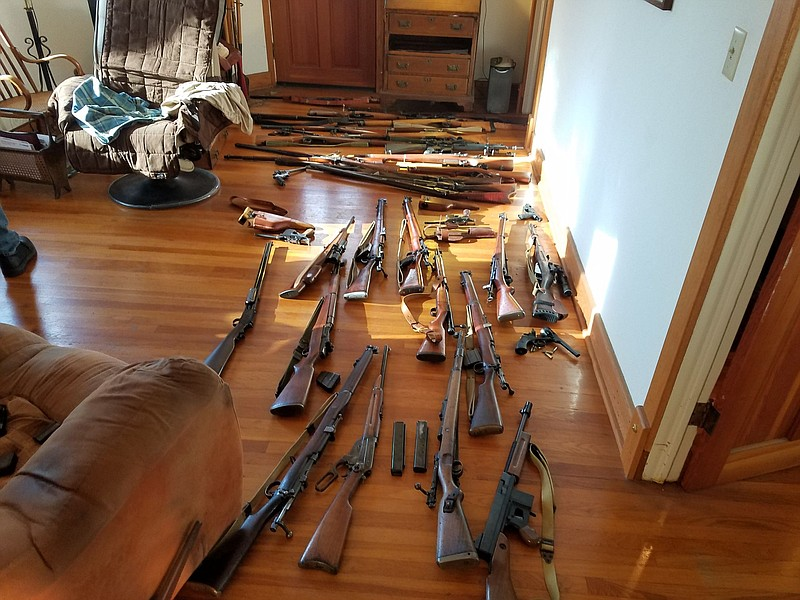 Firearms are shown in the home of Nathan Lee Brogan, who allegedly shot a pub...