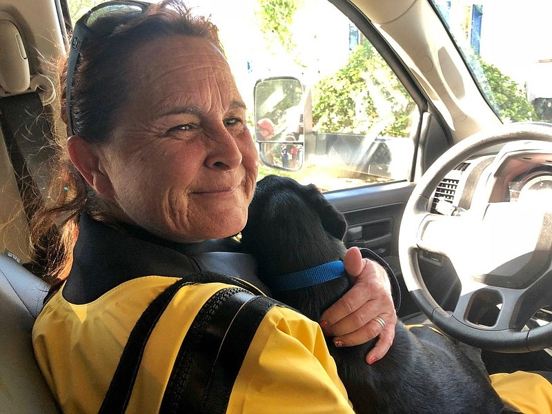 A member of the San Diego Humane Society's Emergency Response Team rescues a ...