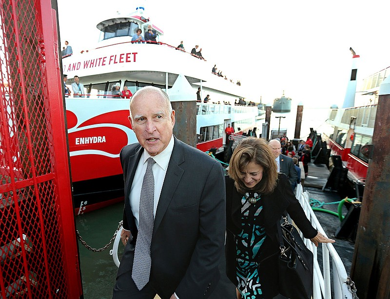 California Gov. Jerry Brown, and his wife, Anne Gust Brown, leave the high-te...
