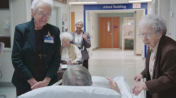 The remaining Sisters of St. Francis visiting patients.