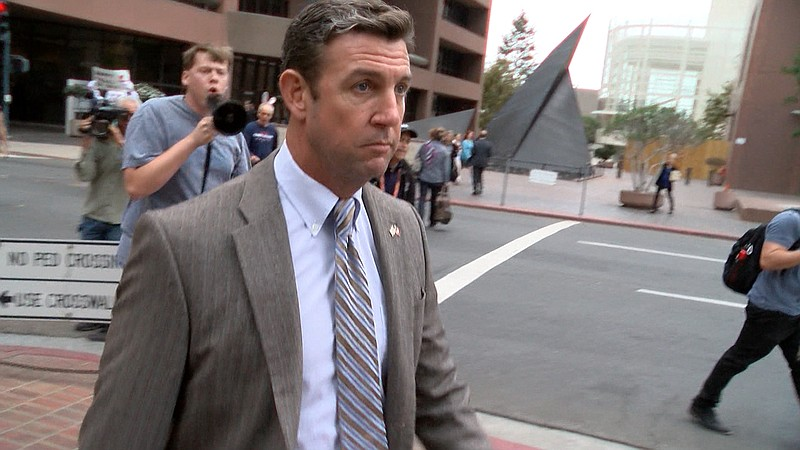 Rep. Duncan Hunter, R-Alpine, leaves his hearing, Sept. 24, 2018.