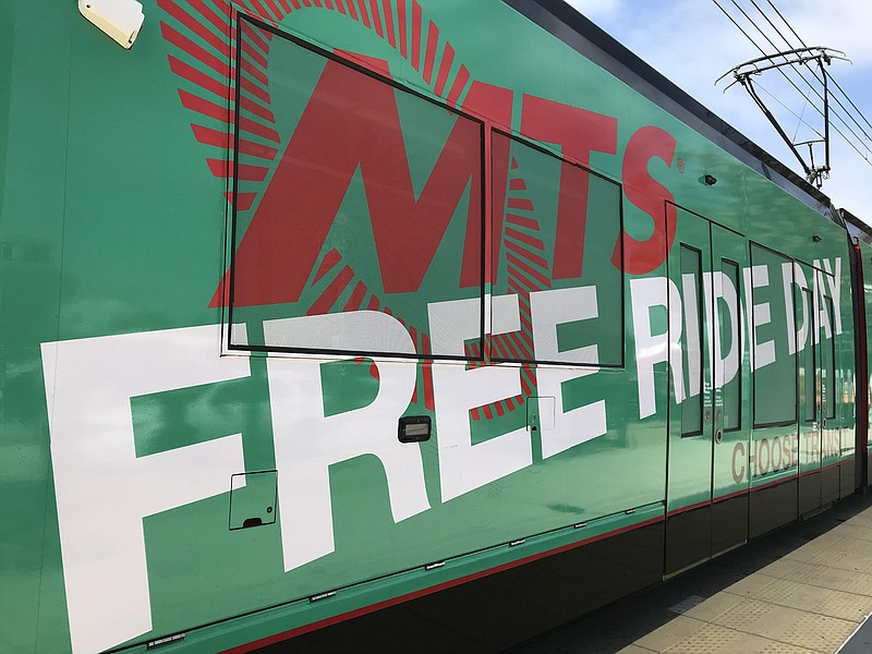 An advertisement for MTS Free Ride Day on Oct. 2 covers a trolley car, Sept. ...
