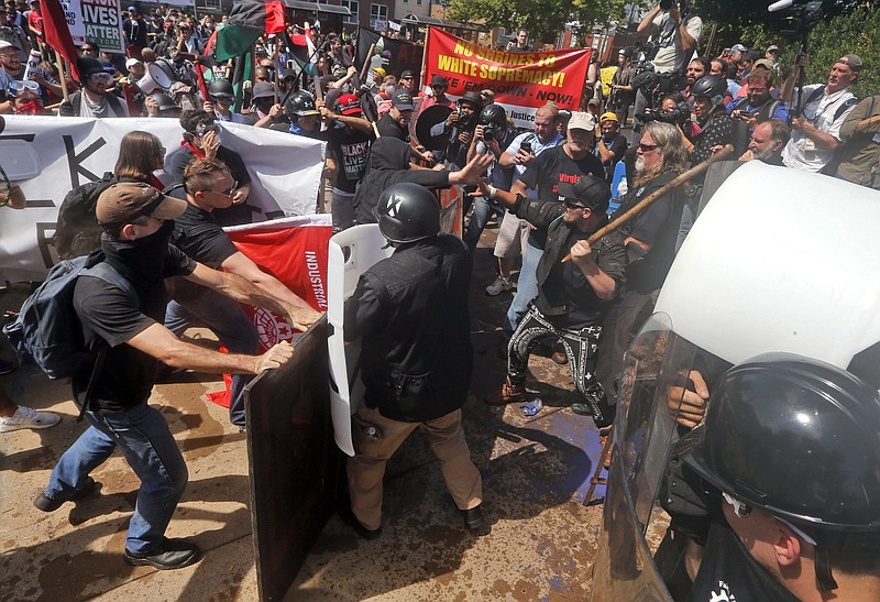 In this Aug. 12, 2017 file photo, white nationalist demonstrators clash with ...
