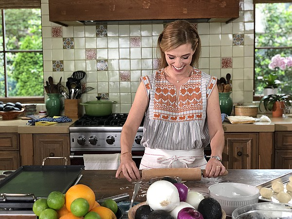 Host and chef Pati Jinich rolling dough for tortillas.