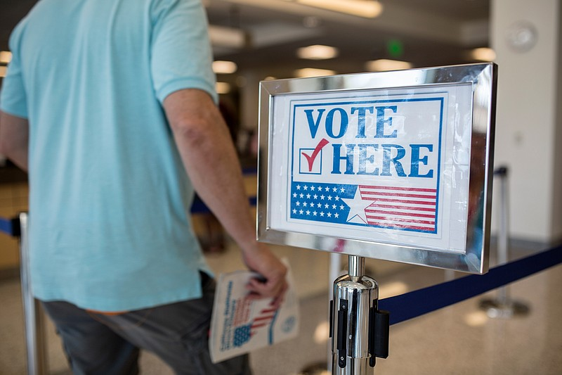 A voter is shown in the San Diego County Registrar of Voters Office in Kearny...
