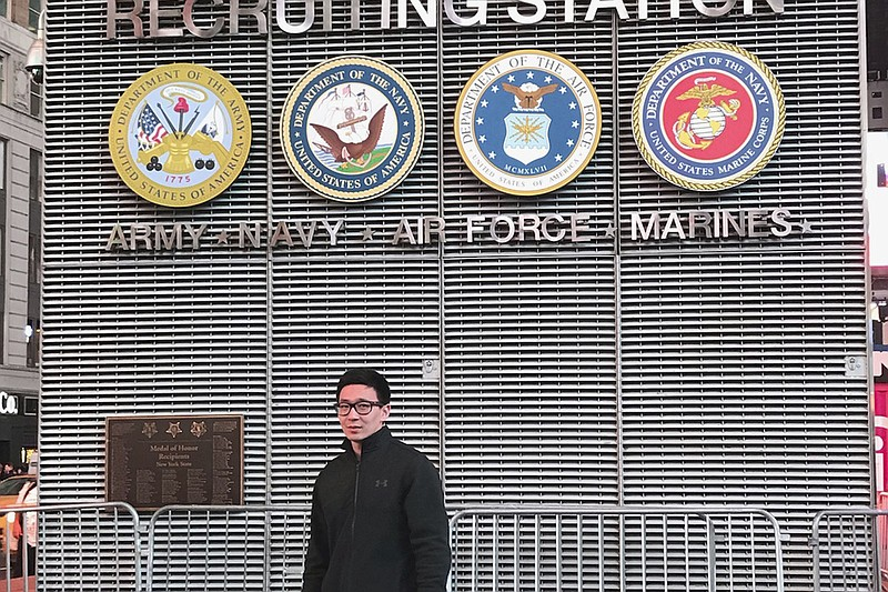 Badamsereejid Gansukh stands in front of a U.S. military recruiting office in...