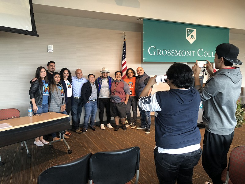 Yosimar Reyes (center, with the hat) poses for a photo with Grossmont College...