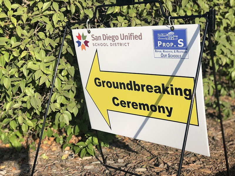 A sign points guests toward a groundbreaking ceremony for a San Diego Unified...