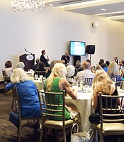Guests enjoying a Q&A session with Steve Breen and Kadir Nelson.