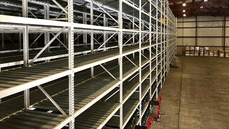 The 20th Street storage facility has 45-gallon bins stacked in metal racks th...