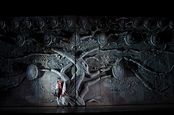 Evan Hughes as Figaro in front of the impressive set for ...