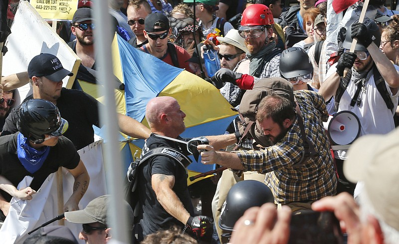 White nationalist demonstrators clash with counter demonstrators at the entra...