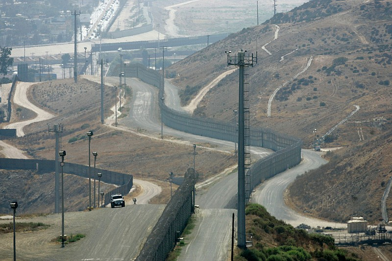A U.S. Border Patrol vehicle is stationed between the primary and secondary f...