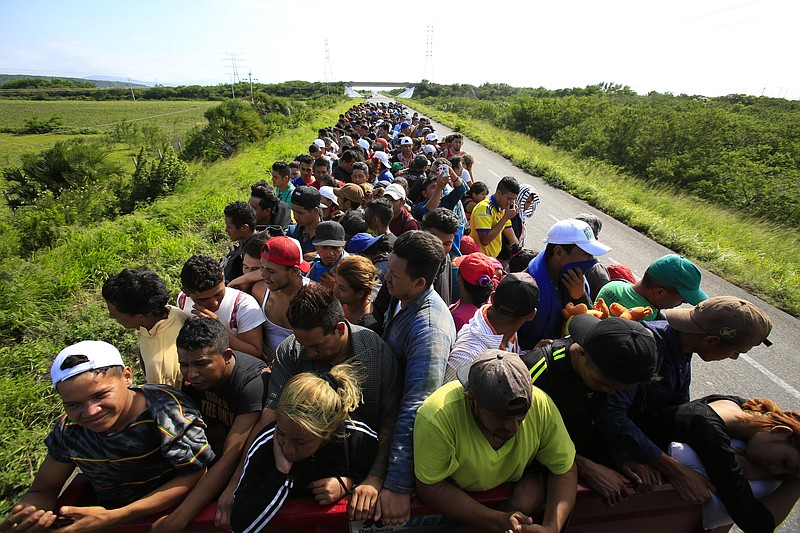 Hundreds of migrants hitch a ride in a truck between Niltepec and Juchitan, M...