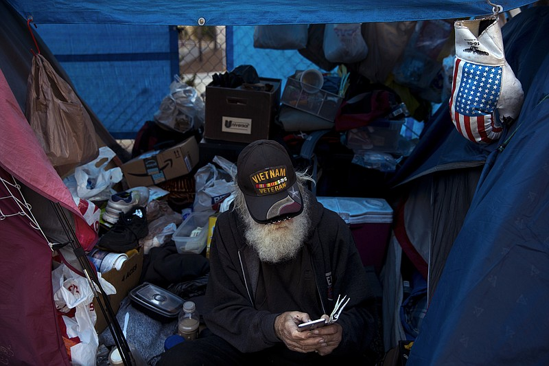 Theodore Neubauer, a 78-year-old Vietnam War veteran, who is homeless, looks ...