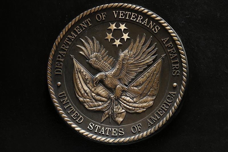 The seal of the Department of Veterans Affairs is seen on the building in Was...