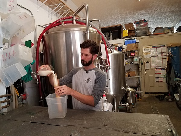 George Thornton works at his North Park brewery Home Brew...