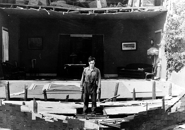 Buster Keaton's memorable stunt of having a house facade ...