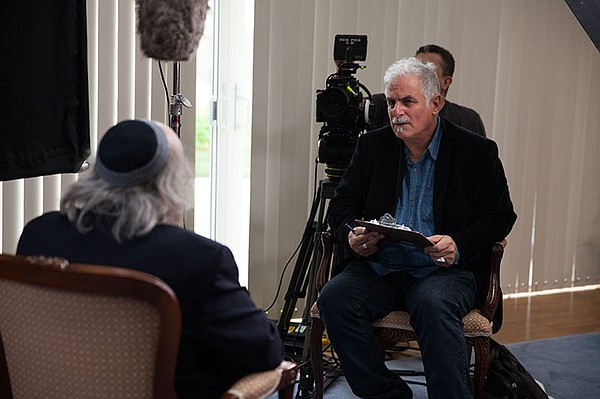A behind-the-scenes photo of Director Isaac Artenstein in...
