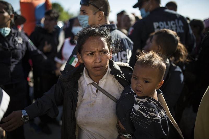 Migrants, who are part of the Central American caravan hoping to reach the U....
