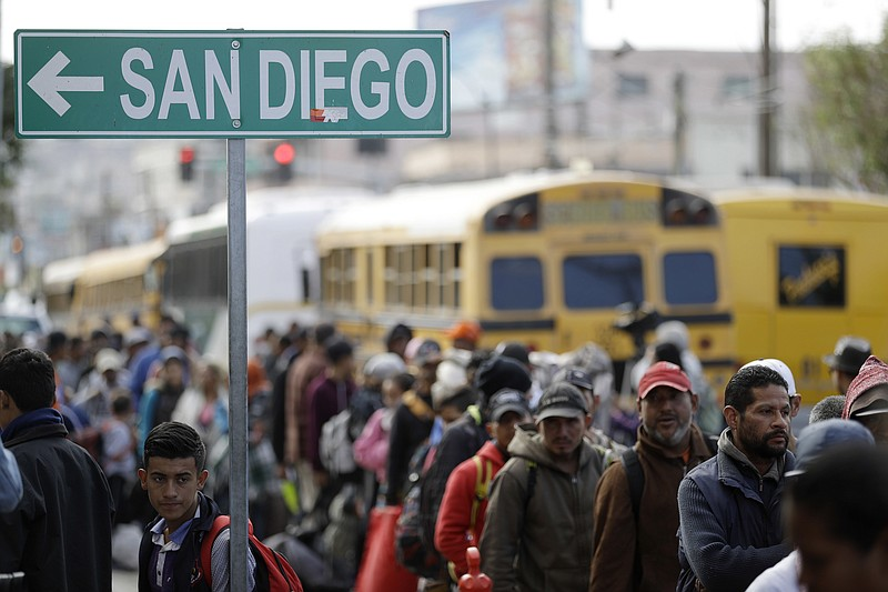 Central American migrants line up for a meal at a shelter in Tijuana, Mexico,...