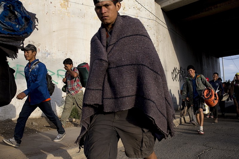 Central American migrants, part of the Central American caravan trying to rea...