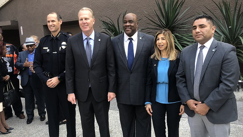 San Diego Mayor Kevin Faulconer poses for a photo with Police Chief David Nis...