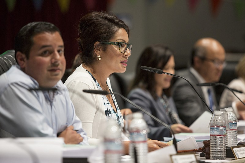 San Ysidro school board President Rosaleah Pallasigue is shown at a meeting a...